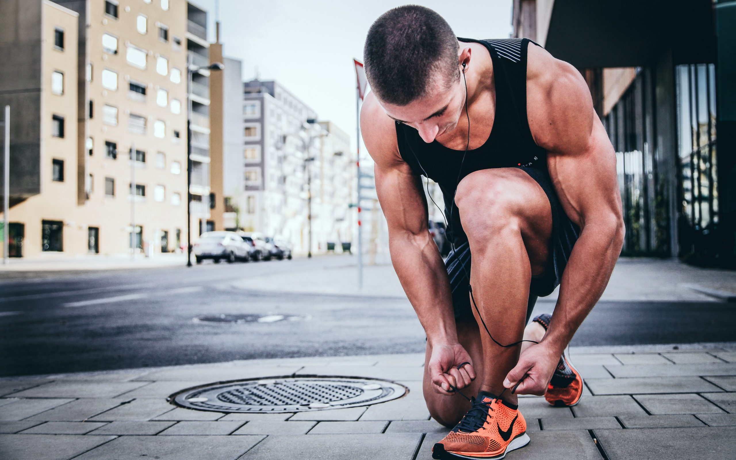 A runner ties his Nike shoes before a long run.