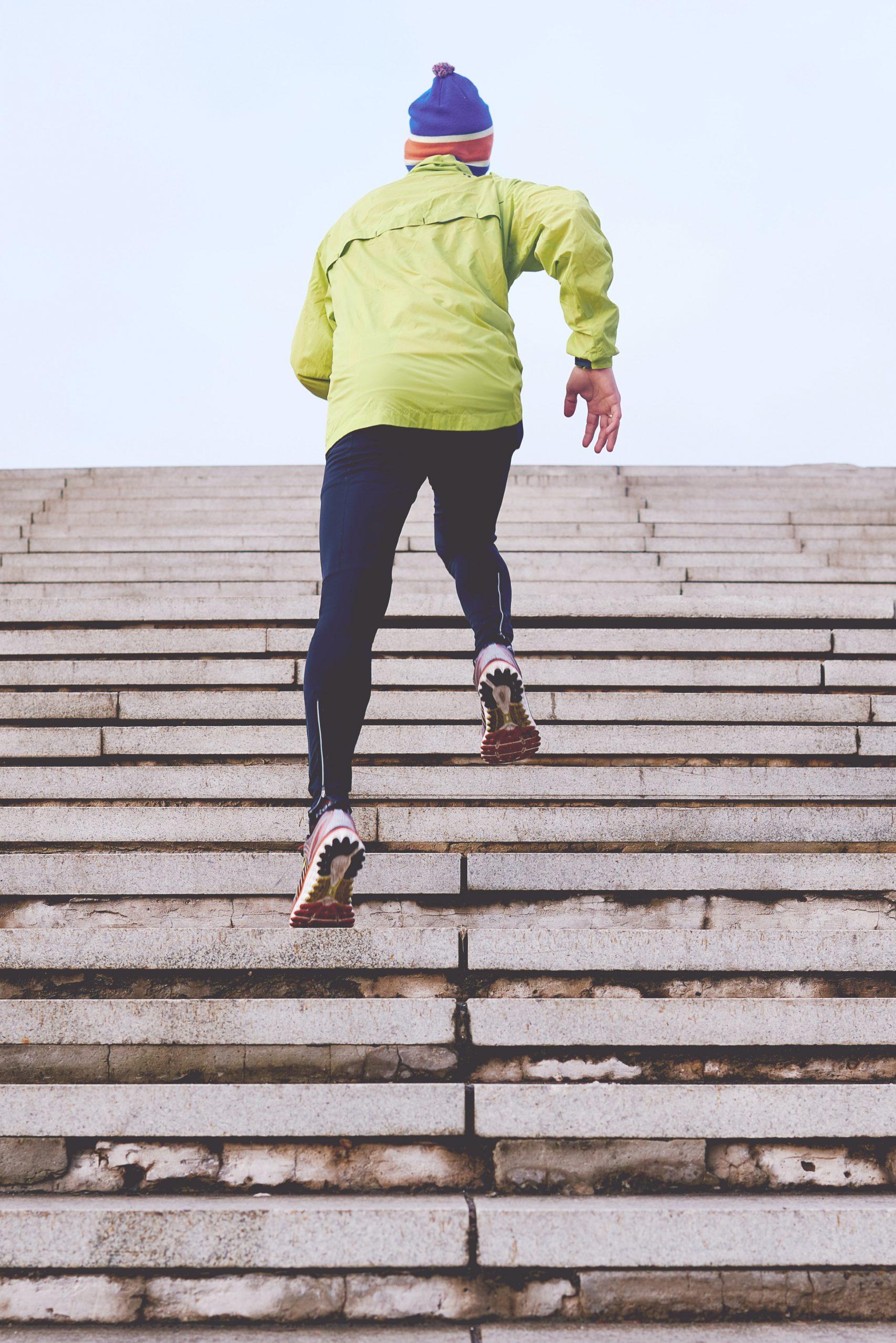 Runner performing a bleacher workout for cross training.